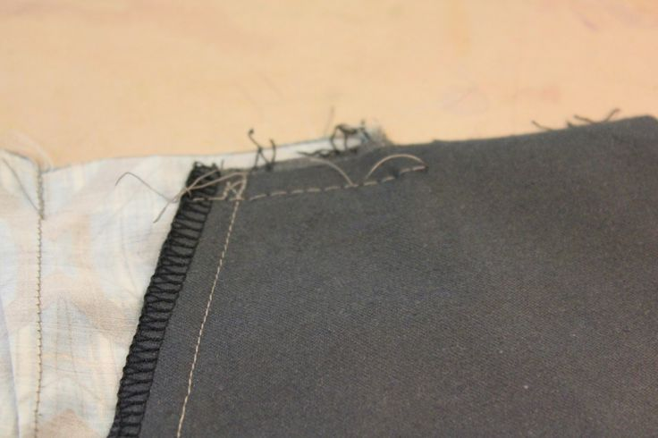 tacking along to of trouser pocket to prevent slipping.
