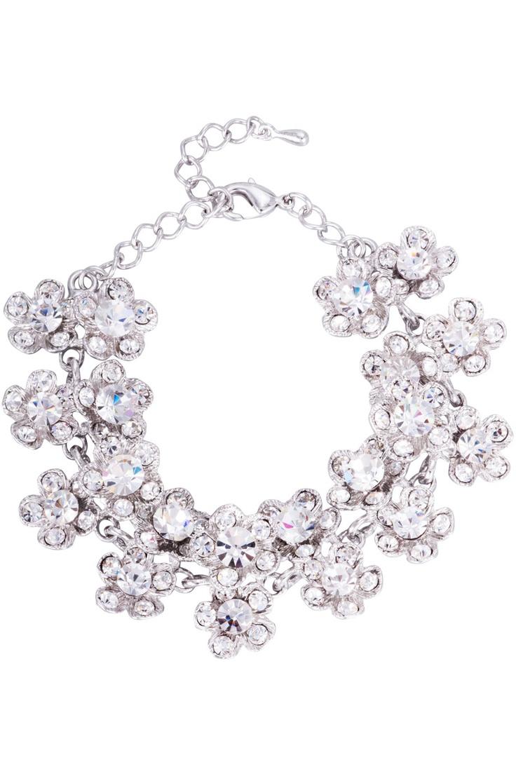 Armband med blommor och vita glittrande stenar.   *Romantic bracelet with 20 glittering flowers