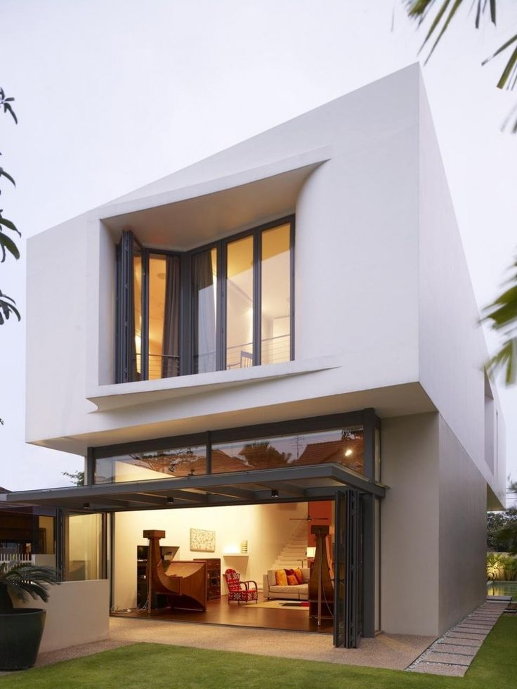 HYLA Architects designed this protruding window detail featuring subtle curves, that add unique character to their Acoustic Alchemy House in Singapore.