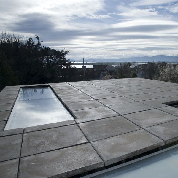 The paving detail of the flat roofs is critical to hide the construction detailing and provide a flat surface.