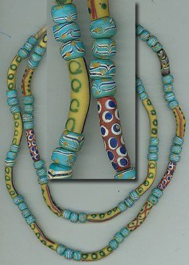 This very rare strand of trade beads measures 36 inches long. There are three bright baby blue trade beads, followed by a tube trade bead measuring about 30 mm long-- that makes up the pattern of this