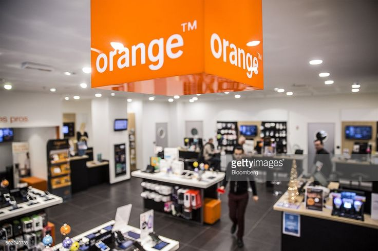 The Orange logo hangs inside an Orange SA mobile phone store in Marseille, France, on Tuesday, Dec. 22, 2015. Orange is in early talks about buying Bouygues SA's phone and television businesses, according to people familiar with the matter, in a move that would reduce the number of wireless carriers in France and follow in rivals' footsteps of bringing telecommunications and media together. Photographer: Balint Porneczi/Bloomberg via Getty Images