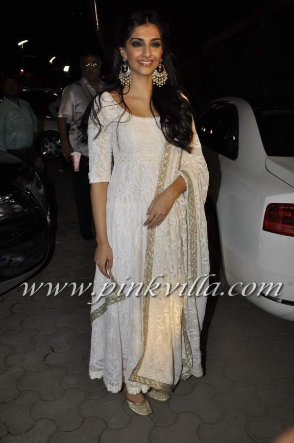 kala tikka on this white ensemble needed for nazarbandi :) beautiful earrings and mojri