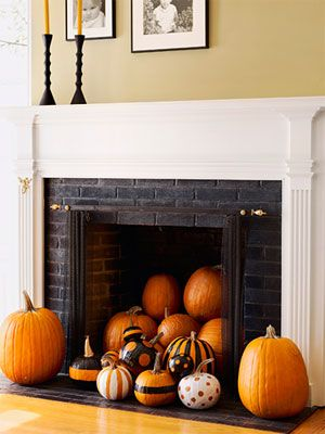 Instead of the usual haunts, try grouping pumpkins in a less-expected locale, like an unused fireplace. #autumn #fall