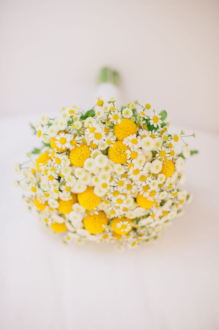 Yellow and white wedding bouquet with wild flowers…