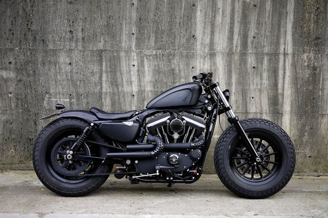 "The Iron Guerrila - Built in 2010 with HD's Dark Custom series out an 883 IRON seems to be a cool bike of its own not trying to make it a totally different bike just to enhance the whole ""dark iron"" look."