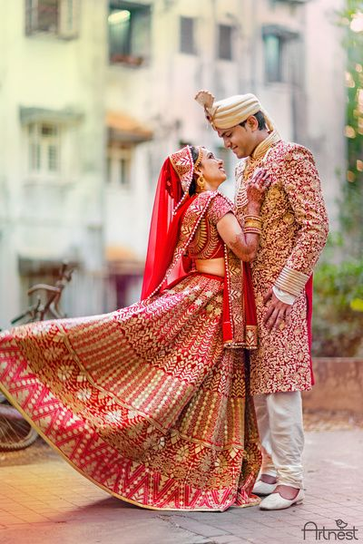 Indian Wedding Photography - Red and Gold Bridal Lehenga and Groom in a Red Sherwani | WedMeGood  #wedmegood #indianbride #indianwedding #lehenga
