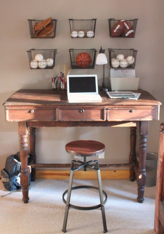desk in boys bedroom with baskets of sports gear on wall - Sports Bedroom Decorating Ideas