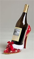 This fun and flirty high heeled shoe Christmas wine bottle holder is trimmed in white fur and a red ribbon bow.  What a fabulously festive way to show off your own bottle of Santas Little Helper.