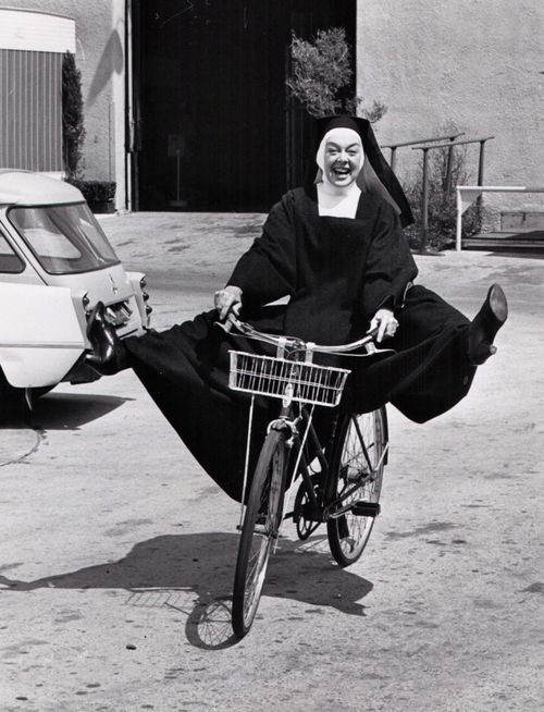 Rosalind Russell rides a bike, habitually.Rosalind Russell The Trouble With Angels Columbia Pictures 1966