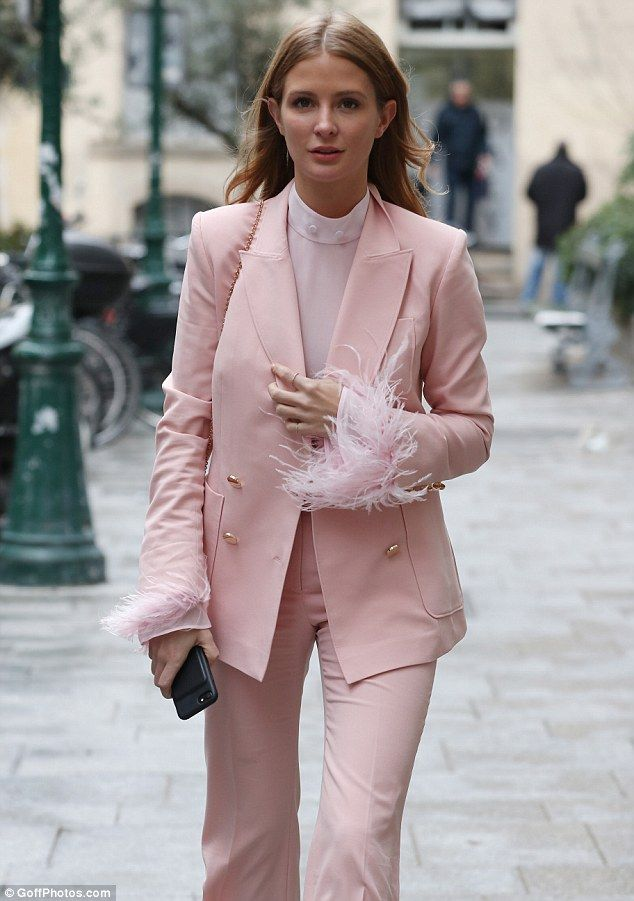 Quick, march: Millie Macintosh, 27, was all about business on Monday as she was seen looki...