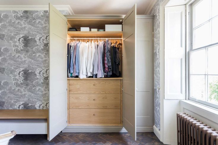 Large cream fitted wardrobe showing interior storage space. Crafted for a home in the centre of Bath >> https://www.bathbespoke.co.uk/portfolio/bath-townhouse-renovation/