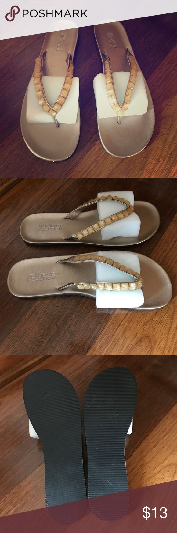 Brand New - Kenneth Cole Gold Flip Flops Never Worn - Size 7 - I love these Beautiful Flip Flops! Received as a gift! Too big for me. They are too beautiful to sit in my closet! Kenneth Cole Reaction Shoes Sandals