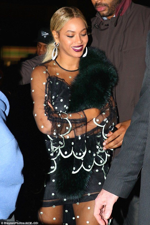 Fur-eezing: Beyoncé shielded herself from the brisk nighttime temperatures with an emerald green mink shawl