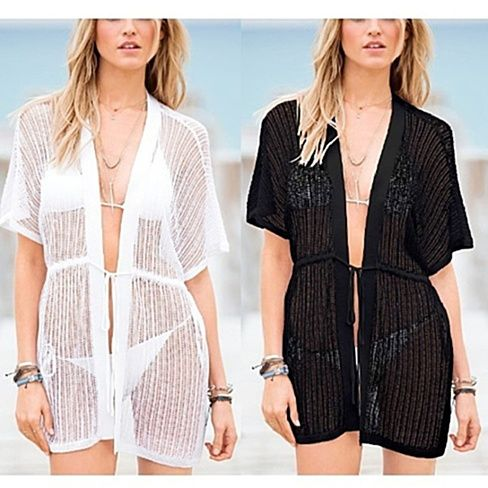 Stun in the sand. Our Dreamer crochet trim swim suit cover up / cardigan is the perfect beach accessory. With an adjustable waistline, the amount of skin you show this summer is up to you. Fashion Tip: This gorgeous cover up doesn't need to be bound only to the beach. you can also wear it as a cardigan over a tank top paired with shorts or jeans.