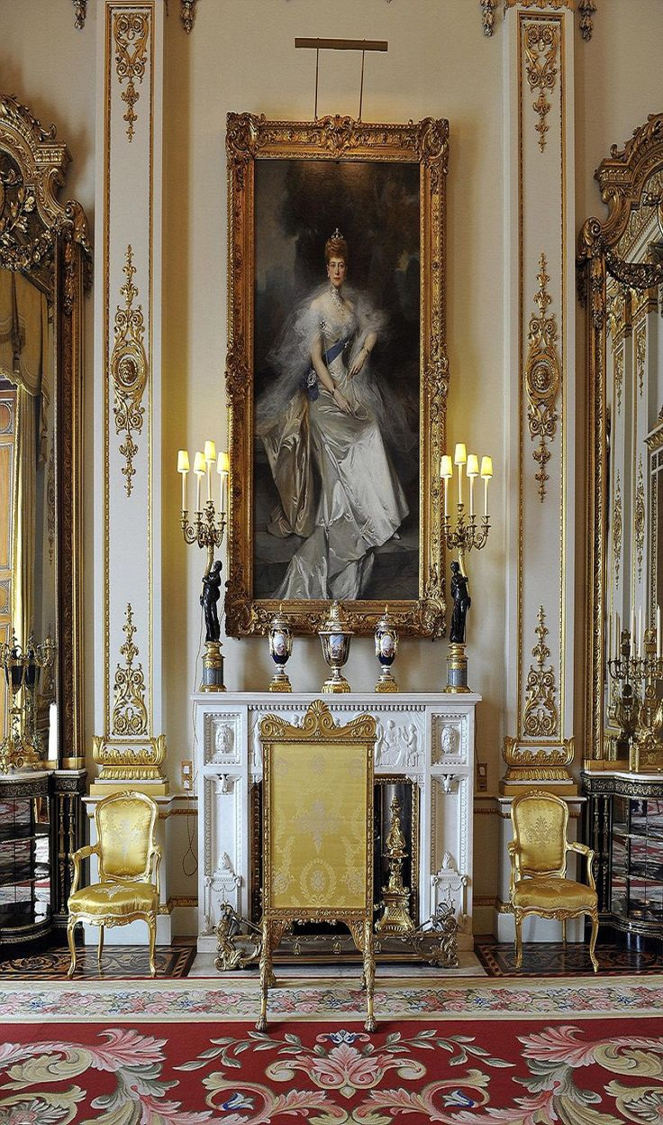 Inside the Buckingham Palace - A portrait of Edward VII's wife Queen Alexandra hangs in the White Drawing Room, the grandest of the state rooms overlooking the gardens. A secret door leading to private rooms allows for a discreet Royal entrance.