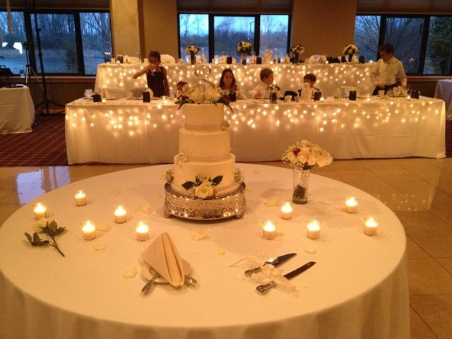 White and Ivory Wedding Cake and Linens! I like how simple the cake table looks:)