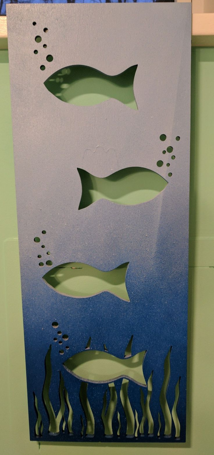 Laser cut fish wall art.