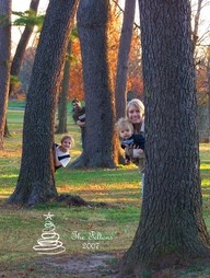 Family picture peeking from behind trees.