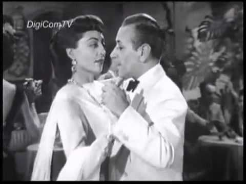 "George Raft and Marie Windsor dance the Tango in ""Outpost in Morocco"" (1949)"