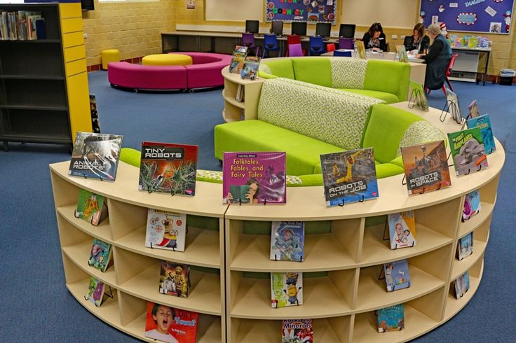 """This stunning """"S"""" seating is the statement piece in Millen Primary Schools library. We love the way the librarians are display the books on the curved shelving."""