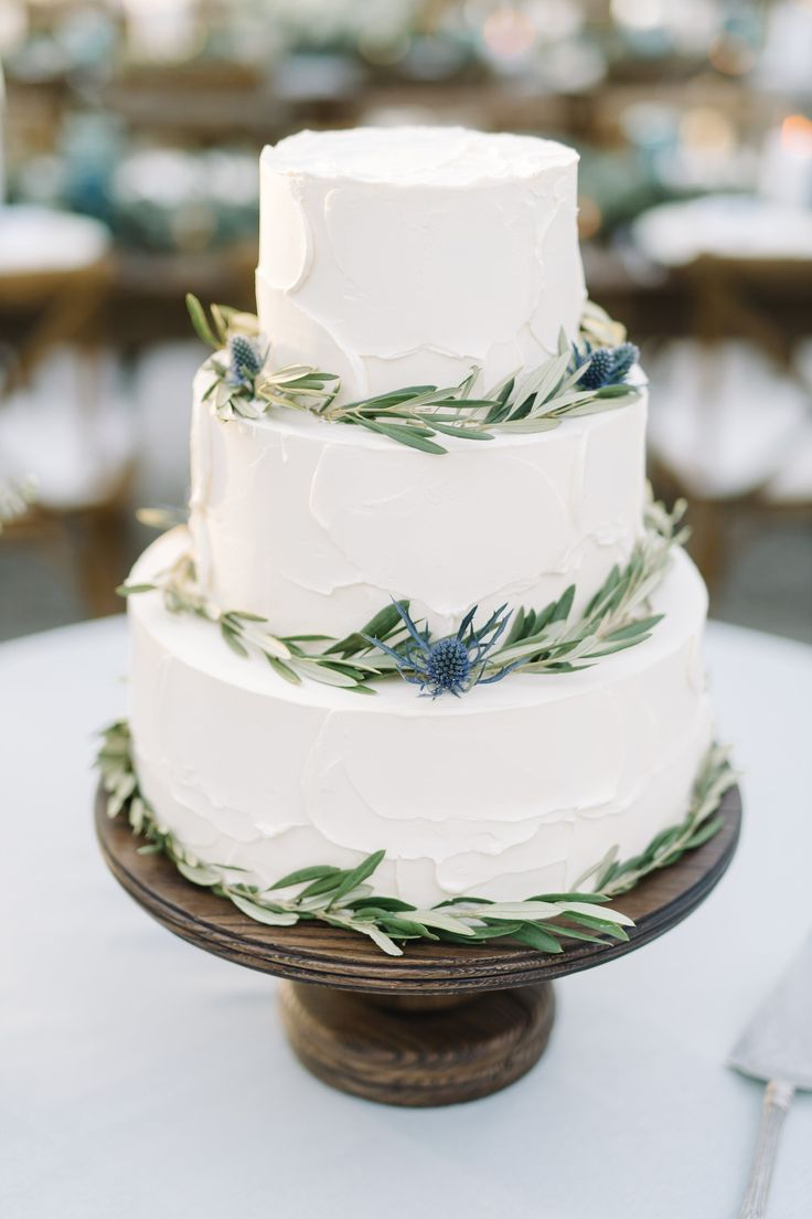 3 Tier Sweet Pea Buttercream Wedding Cake with Greenery Accents & wood cake stand || Patrick Properties Hospitality Group Pastry Chef  Jessica Grossman || Charleston, SC