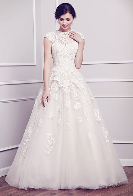 A classically-inspired look with the use of cotton lace build up finished with a ball gown skirt. Zipper back.