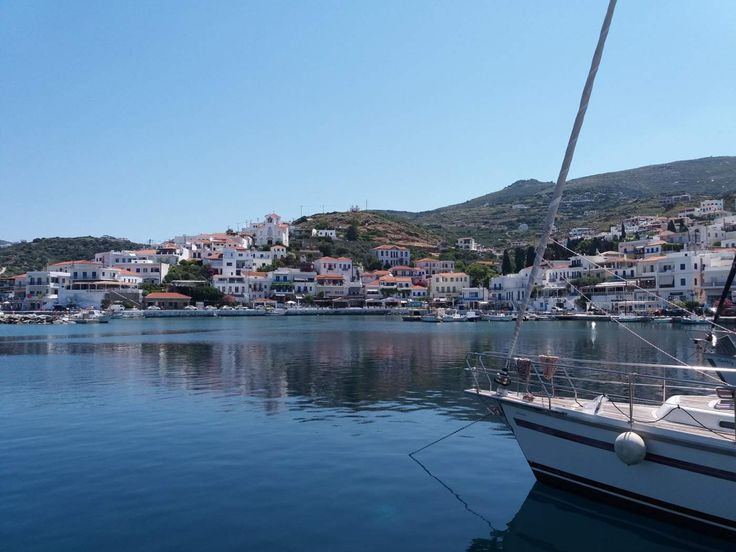 Greece - Island of Andros - Batsi once a fishing village, is now a major tourist resort on the island of Andros, although it has kept its traditional and picturesque charm. Its red-tiled colored houses have been built amphitheatrically and encircle the bay with its lovely fishing harbour.