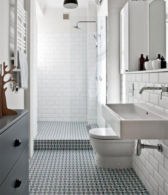 Classic metro tiles combined with patterned floor tiles creates a timeless look.