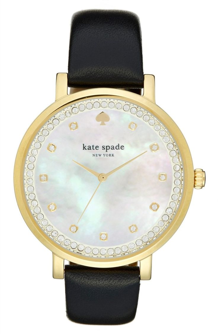 Sparkling crystals mark the hours and ring the mother-of-pearl dial of this polished round watch set on a smooth leather strap. A gorgeous Kate Spade find from the NSale!