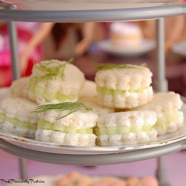 Pink Piccadilly Pastries: Cucumber sandwiches cut out with cookie cutters and garnished with dill