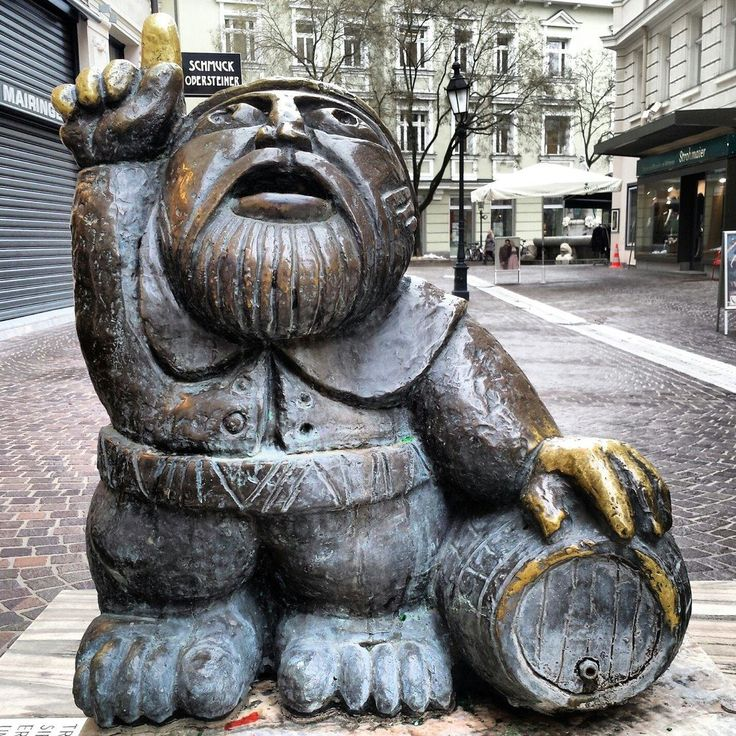 Woertherseemandl (statue) - Klagenfurt, Austria. Haha I've thrown cents into this.