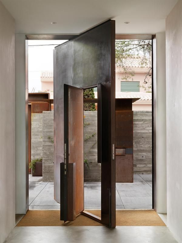 With the larger door open, the entry courtyard becomes available for large family gatherings.