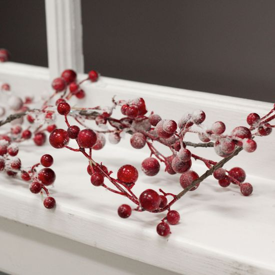 The Snowy Berry Garland will create a modern country holiday feel in your home.