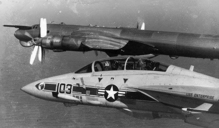 "Grumman F-14A Tomcat of VF-1 ""Wolfpack"" escorts a Russian Navy Tupolev Tu-142 ""Bear"""