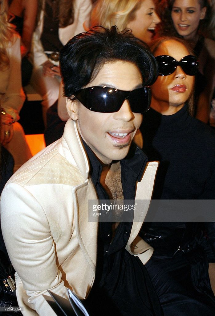 US singer Prince is pictured during Italian fashion house Gianni Versace show during the Spring/Summer 2007 women's collections, 29 September 2006 in Milan.
