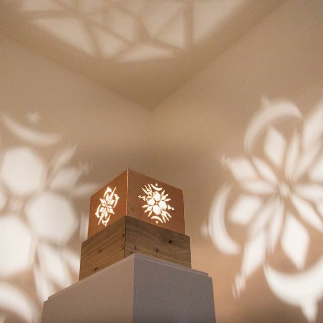 Installation projection copper and wood 'universal patterns' 2015  Artist Georgia Steele