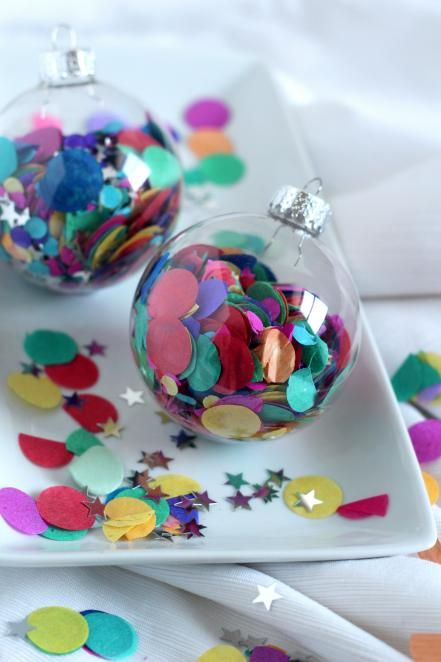 These confetti ornaments are a party for your tree, and they're a fun DIY project for the kids, too. Use store-bought confetti or have the kids punch out some colorful paper with a hole punch. Carefully fill each glass ornament with the confetti pieces. Add in a few metallic stars for extra holiday sparkle.