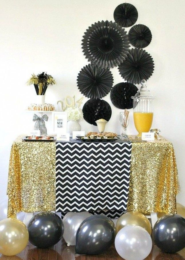 Combine chevron patterns with glitter for the perfect NYE dinner party decorations.