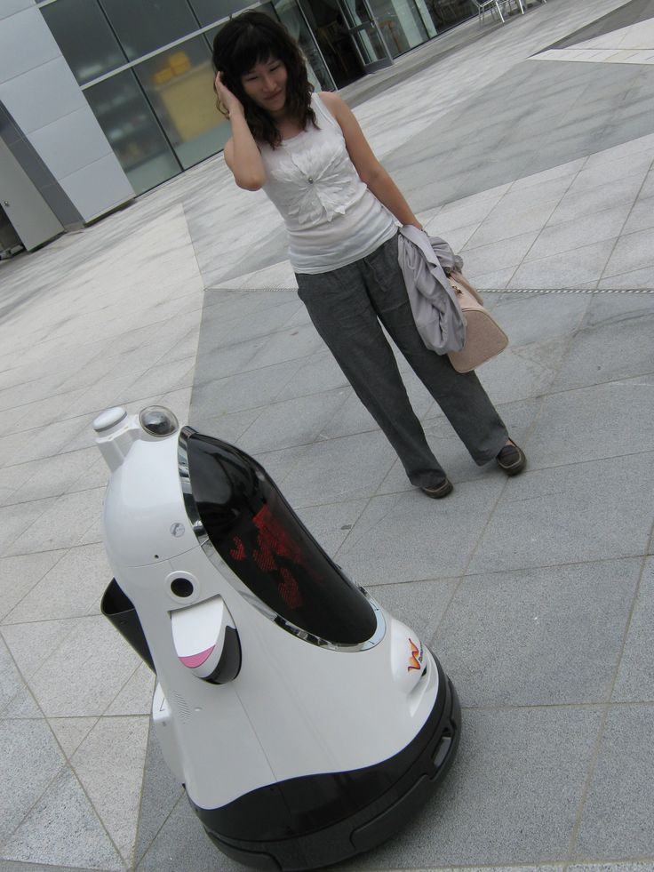 Yuri being chatted up by a robot, 2009