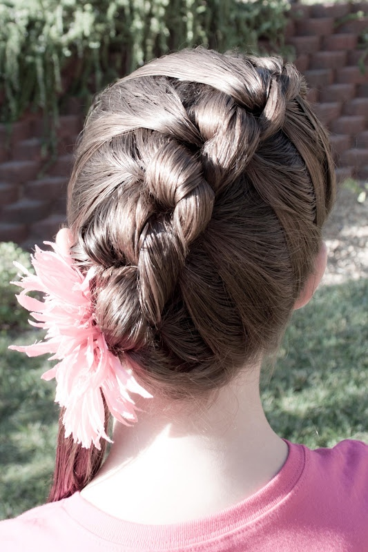 French Knot with an instructional video @ Princess Piggies.  This one is an easy one to do on yourself as well.