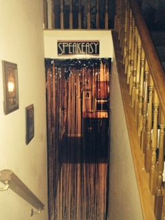 """When I was asked to throw a Roaring 20s Theme party for a friends birthday, I knew exactly where to start. Shindigz """"dark brown brick paper"""" was perfect as the backdrop for my speak ea…"""