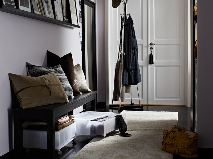 Sleek storage A tiny hallway is made cosier with mixed fabric textiles, warm lighting and smart storage and display.