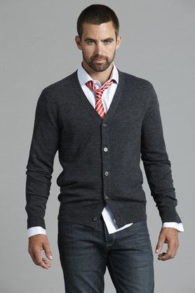 button up sweater, dress shirt and skinny tie... one of my favorite business casual outfits for a man. (but please tuck your shirt in if it hangs out!)