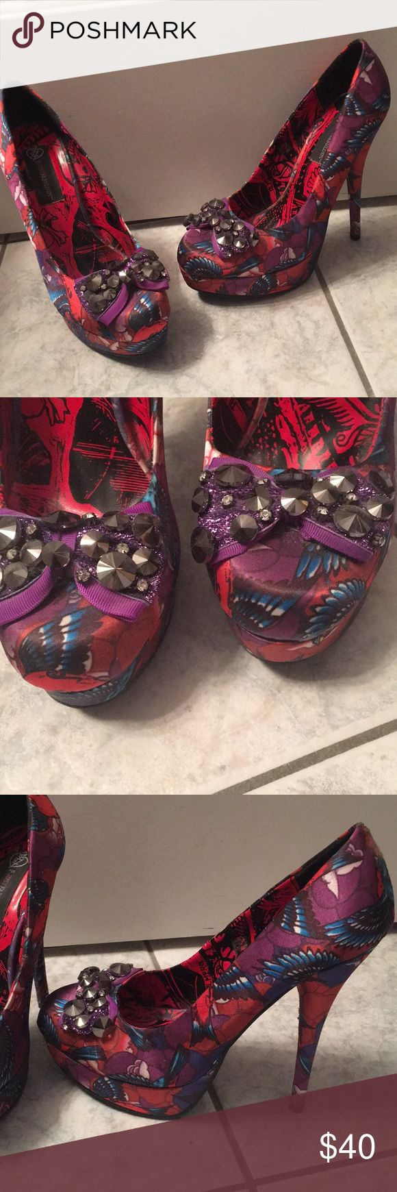 Pink and Purple Heels Purple/pink/blue/black patterned, purple bow on front with grey gems, NEVER WORN, size 10, very high heel Shoes Heels