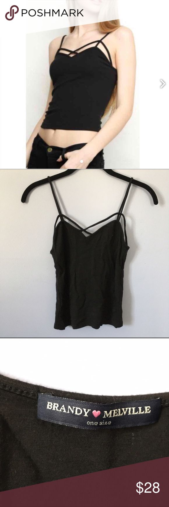 Black Strappy Criss Cross Tank Top Adorable black stretchy tank top with a strapping cross cross front! Perfect for layering or by it self! Never worn! Brandy Melville Tops Tank Tops
