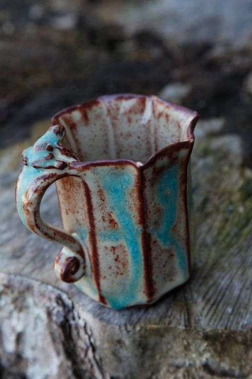 pottery cup   very unique glazes that work well together  The shape is interesting as well