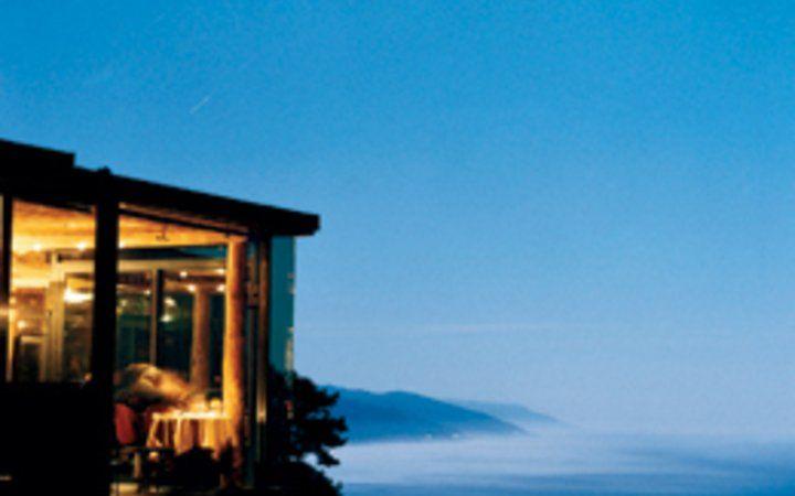 Post Ranch Inn's Sierra Mar restaurant at dusk.