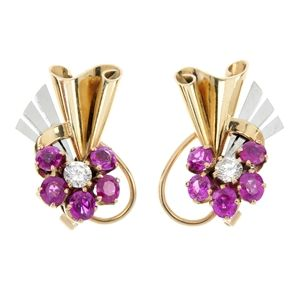 A pair of Retro diamond and ruby ear clips.