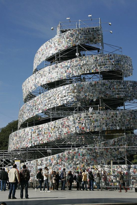 "Called The Tower of Bable in Buenos Aires. An 82-foot-tall tower made out of thousands of books — 30,000 such ""bricks"" to be precise. We can see book lovers' eyes light up with glee in view of all the reading material, only to be extinguished by the thought of such a waste. But bookworms and environmentalists can relax and rejoice! Not a single volume was harmed in the process of building this massive structure."